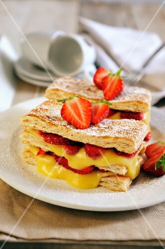 Puff pastry slices with cream and strawberries