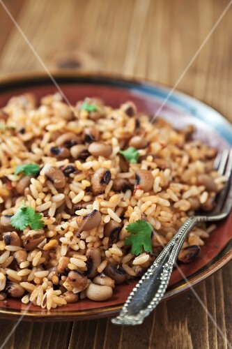 Rice and black eyed peas with cumin and mustard seeds topped with fresh cilantro