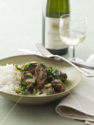 Beef and Wilted Greens with Rice; Fork and Knife; White Wine