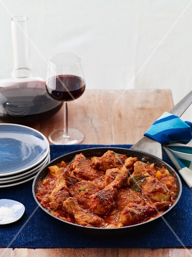 Tomato Based Chicken Stew Cooked in a Skillet; With Red Wine