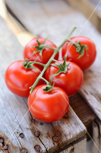 Vine tomatoes on a wooden crate