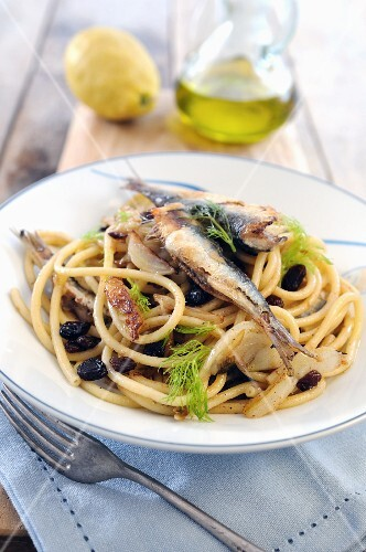 Bucatini pasta with pan fried sardines, fennel and raisins