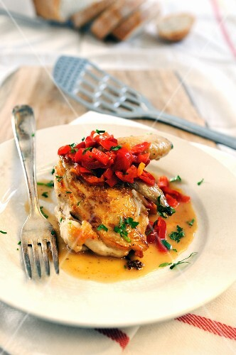 Half a chicken with sweet and sour bell pepper sauce
