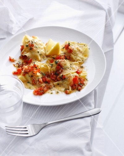 Plate of prawn ravioli with tomato sauce