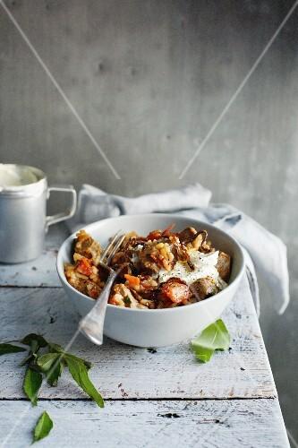 Bowl of lamb biryani with herbs