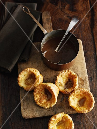 Board with Yorkshire pudding and gravy
