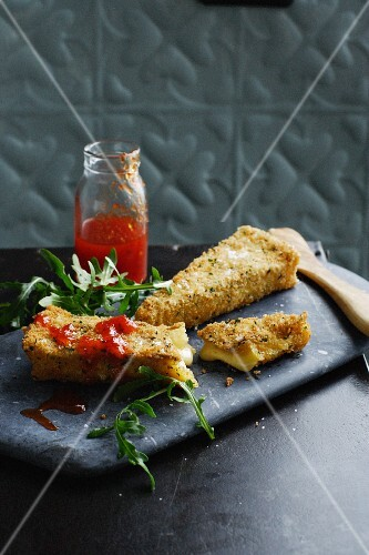 Deep fried slices of brie cheese