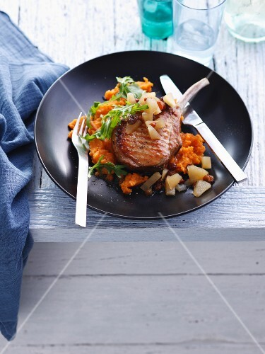 Plate of pork cutlets with vegetables