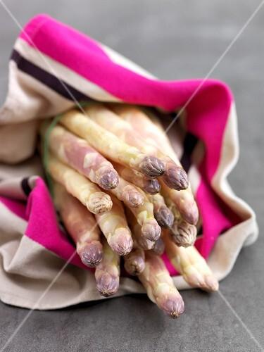 White asparagus on a stripped cloth