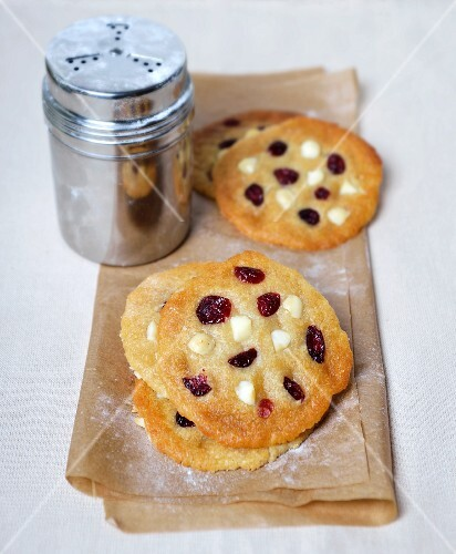 Macadamia nut and cranberry cookies and a sugar shaker