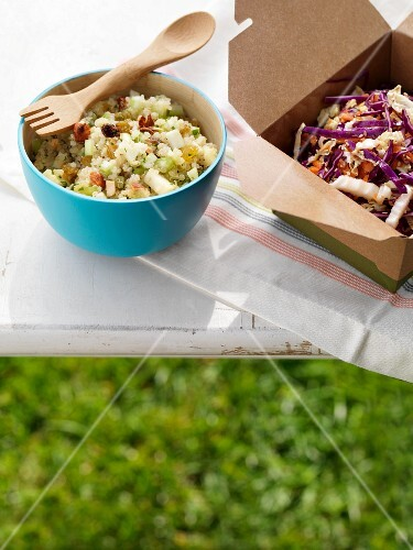 Two Side Salads on an Outdoor Table; Quinoa Salad and Cole Slaw