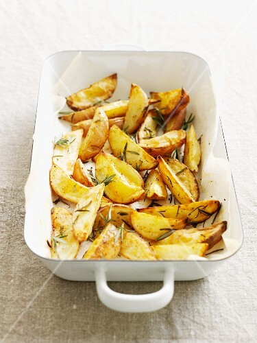Dish of roasted potatoes with herbs