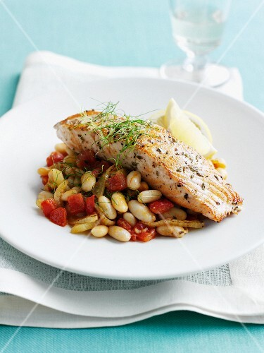 Plate of fish with beans and tomatoes