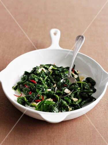 Dish of wilted greens with herbs