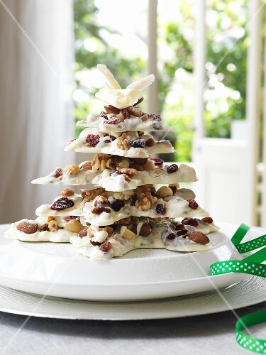A white chocolate tree with dried fruits and nuts for Christmas