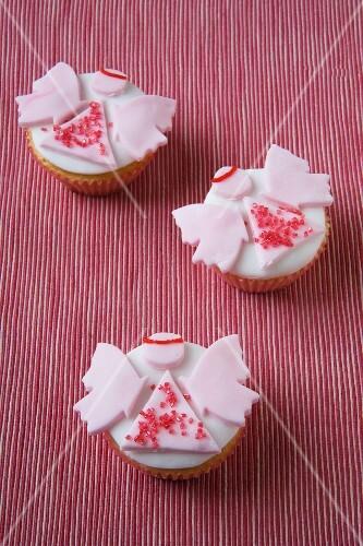 Three angel cupcakes