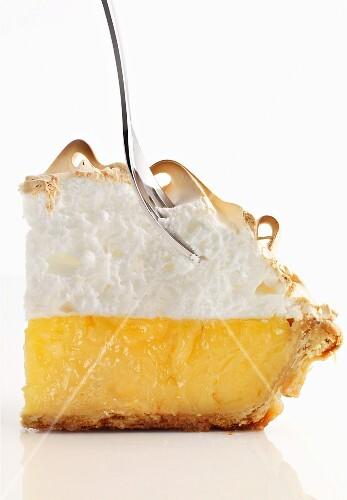 Lemon meringue pie with a fork