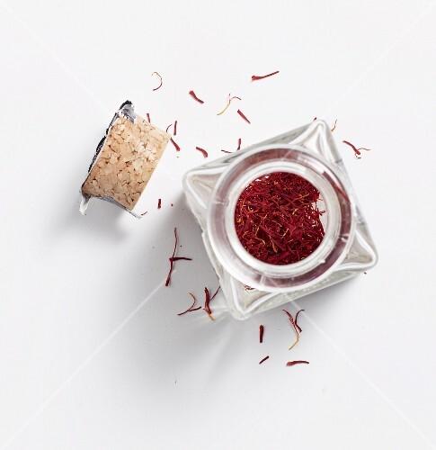 Saffron threads in a glass jar with a cork