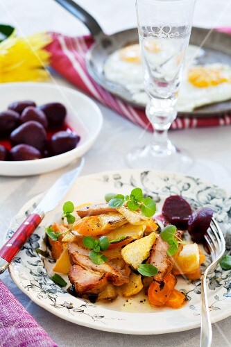 Smoked pork with root vegetables and beetroot