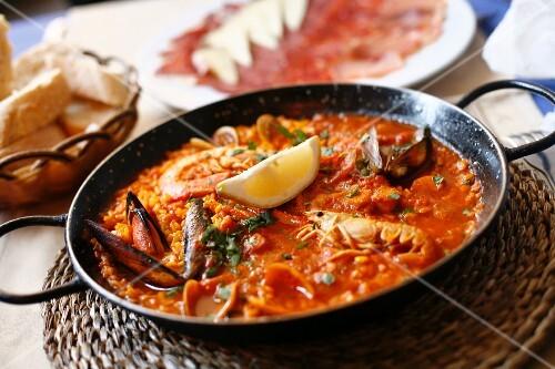 Traditional Paella at Restaurant at La Boqueria Market in Barcelona, Spain