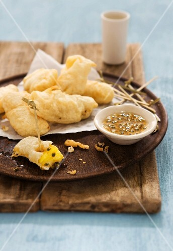 Pineapple tempura with passion fruit sauce