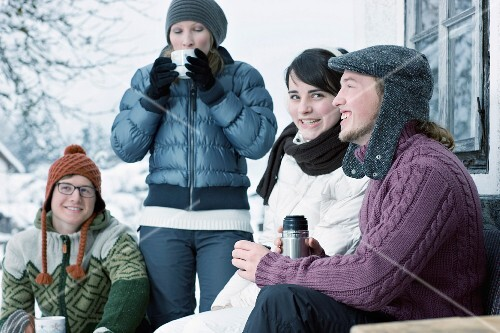 Group of young people drinking warm tea