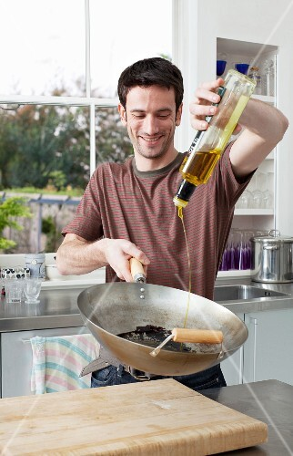 man cooking in the kitchen