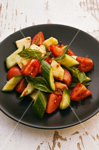 Tomato and cucumber salad with pineapple and basil