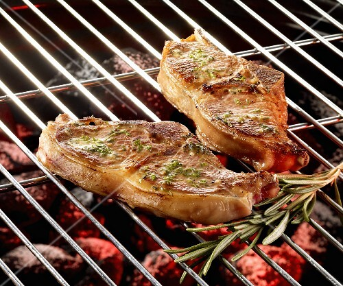 Lamb cutlets with herb marinade on the grill