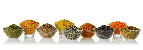 Various types on legumes in glass bowls