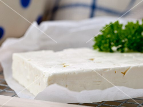 Feta with parsley on a piece of paper