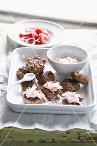 Grilled meat balls with a radish dip
