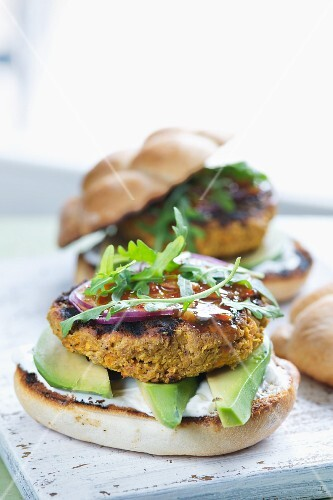 Carrot and sesame seed burger with avocado