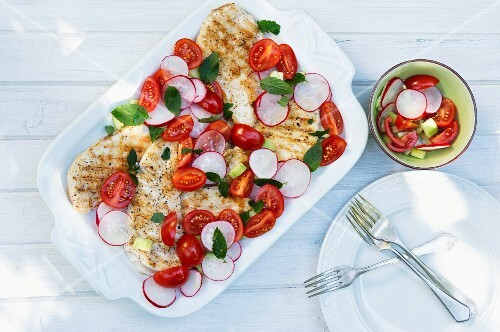 Grilled chicken breast with tomatoes and radishes
