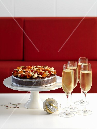 Christmas fruit cake and champagne glasses