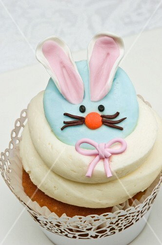 A cupcake decorated with an Easter bunny