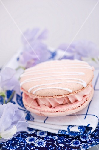 A pink macaroon filled with buttercream