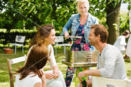 Young people chatting at a barbecue