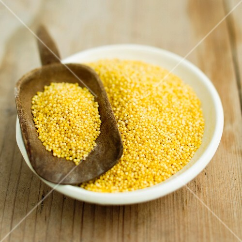 Millet in a bowl and on a scoop