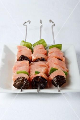 Three raw pork kebabs
