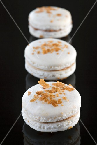 White macaroons with chocolate cream
