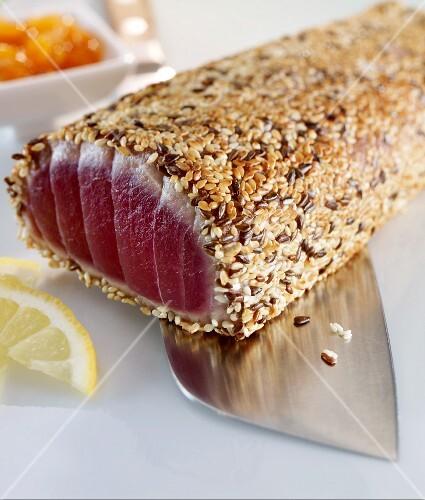Tuna with a sesame seed crust on a knife