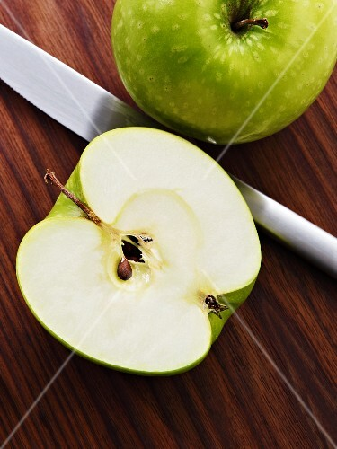 Granny Smith apples, whole and halved