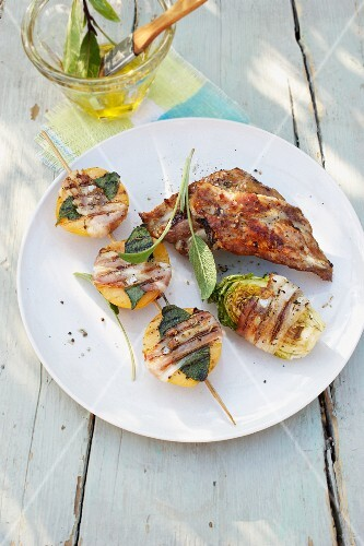 Grilled spare ribs with chicory and apricots wrapped in ham