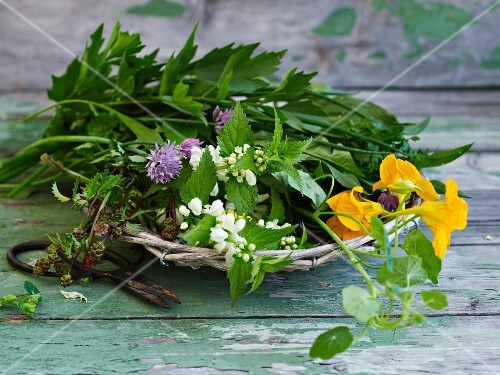 Fresh herbs with flowers in a wicker basket