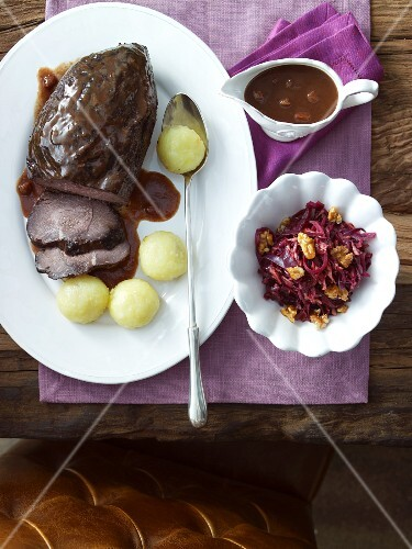 Marinated pot roast with raisin sauce, dumplings and red cabbage salad