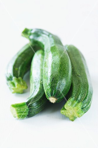 Four courgettes