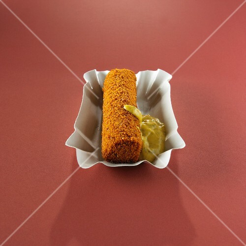 A meat croquette with sweet mustard (Holland)