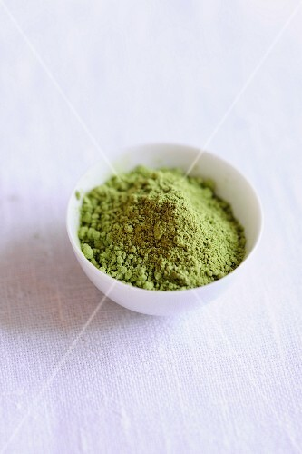 A bowl of matcha tea powder