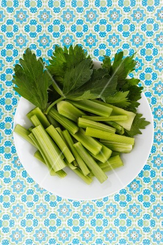 A plate of fresh celery, sliced (seen from above)